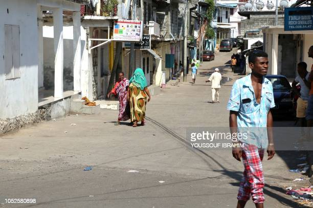 Residents walk in a deserted streets of Mutsamudu the capital of the Comoros archipelago island of Anjouan on October 20 2018 The Comoros government...