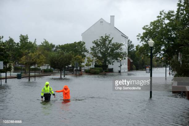 Residents walk in flooded streets as the Neuse River floods its banks during Hurricane Florence September 13 2018 in New Bern North Carolina Coastal...