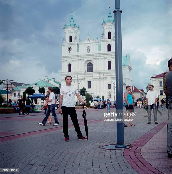 Residents walk in the main square on July 22 2011 in Grodno Belarus Grodno is a city in northwest Belarus on the border with Poland Women officially...