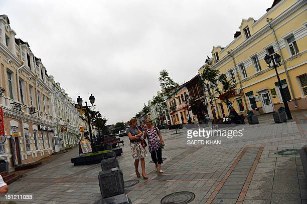 Residents walk in the old part of town prior to the AsiaPacific Economic Cooperation in Vladivostok on September 4 2012 APEC leaders' summit in...