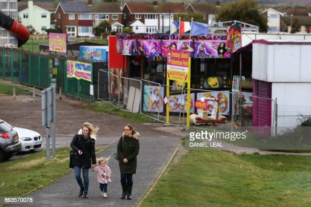 Residents walk near the seashore on Canvey Island Essex on October 20 2017 A small island community in the Thames Estuary that voted massively for...
