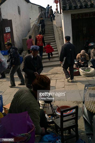 Residents walk on a bridge at the Shantang Street at the old urban area of Suzhou on February 20 2008 in Suzhou of Jiangsu Province China Suzhou...