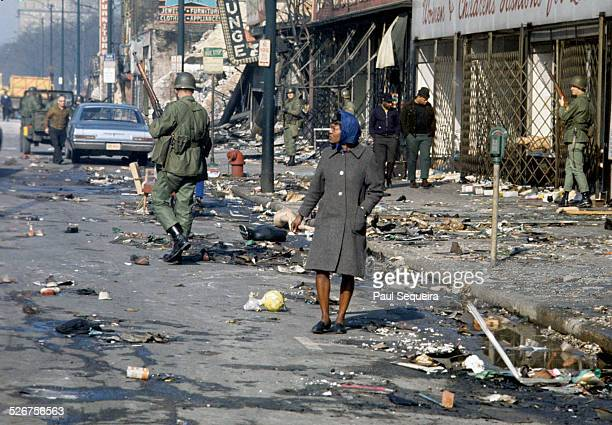 Residents walk on city streets while soldiers patrol to stem the rioting that occurred in response to the killing of Martin Luther King Jr Chicago...