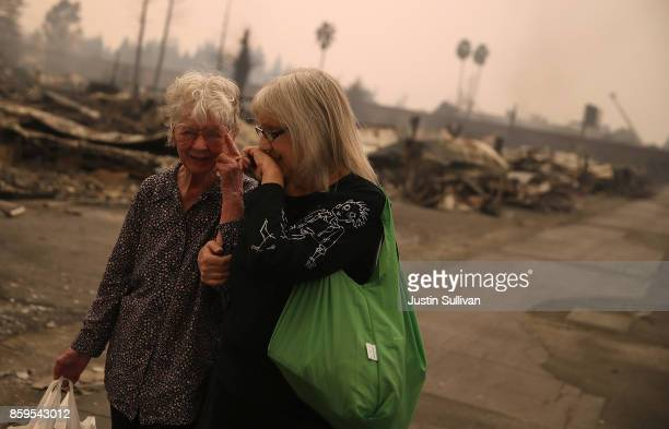 Residents walk through the fire damaged Journey's End Mobile Home Park on October 9 2017 in Santa Rosa California Ten people have died in wildfires...