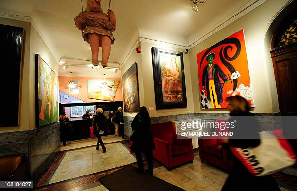 Residents walk through the lobby at the Chelsea Hotel in New York January 10 2011 The Chelsea Hotel a haven for struggling artists for over 50 years...