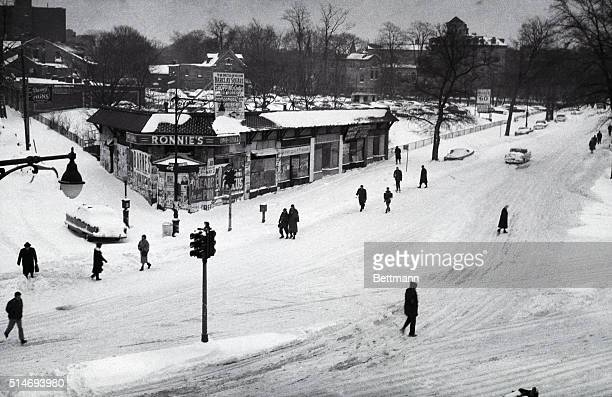 Residents walk through the snowcovered streets of Flushing New York after 14 inches of snow fell the previous day March 4 1960