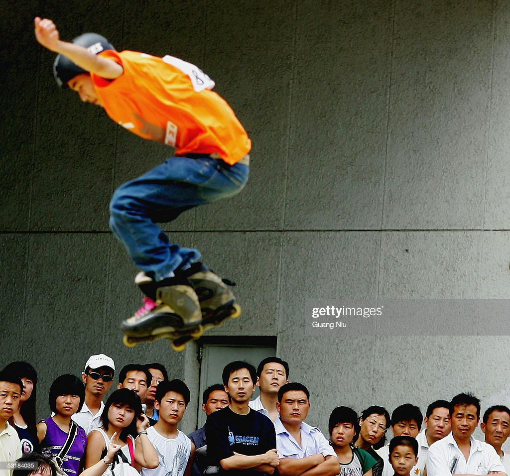 Residents watch a competitior in the Extreme Sports Games on July 2, 2005 in Beijing, China. Local authorities are gearing up to promote sporting activities in the city as the 2008 Beijing Olympics is approaching.