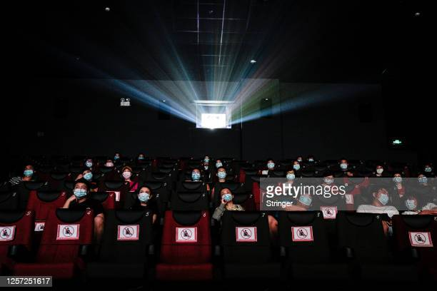Residents watch a movie in a cinema in Wuhan on July 20, 2020 in Wuhan ,Hubei Province,China.Taking various measures against COVID-19, cinemas in the...
