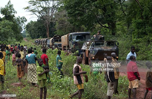 Residents watch as a convoy of French troops of the Sangaris forces patrol in Grimari in the center of the Central African Republic on April 16 2014...