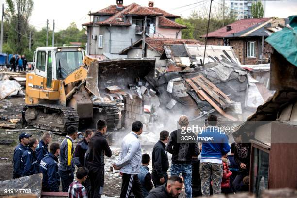 Residents watch as bulldozers raze homes in the Roma quarter of Sofia At least 20 homes deemed illegal were destroyed by the local municipality...
