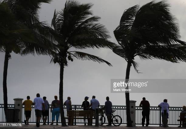 Residents watch as watch the heavy surf during a mandatory evacuation as Hurricane Dorian inches closer to the U.S. On September 2, 2019 in Vero...