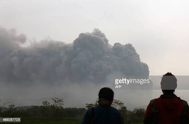 Residents watch the eruption of Mount Kelud volcano from Kediri town in East Java province on February 14 2014 Two people have been crushed to death...