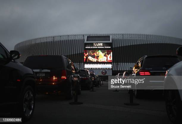 Residents watch the movie 'Trolls' at a drive-in movie arranged by Nassau County at the parking lot of NYCB's LIVE at the Nassau Coliseum on May 29,...