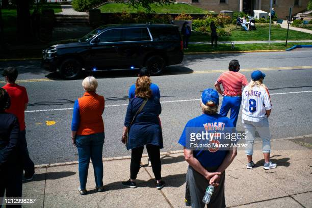Residents watch the procession during the funeral of Glen Ridge Police Officer Charles Roberts after he passed away from the coronavirus on May 14...