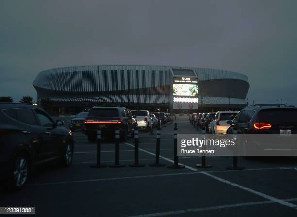 Residents watch 'Trolls' at a drive-in movie arranged by Nassau County at the parking lot of NYCB's LIVE at the Nassau Coliseum on May 29, 2020 in...