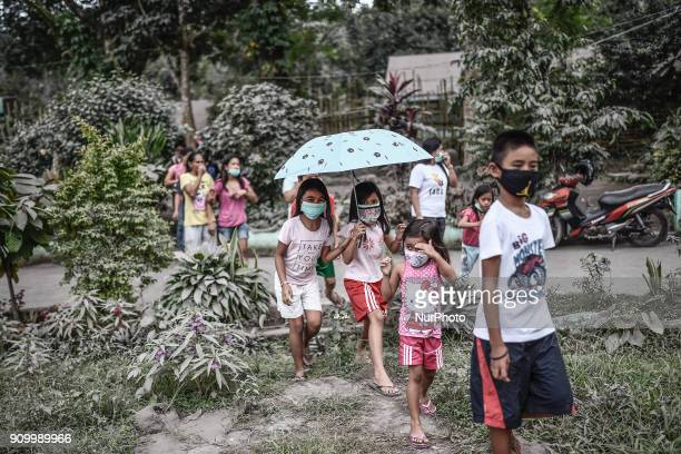 Residents wear face masks amidst heavy ashfall at an evacuation center in Camalig Albay province Philippines January 24 2018 Mount Mayon the...