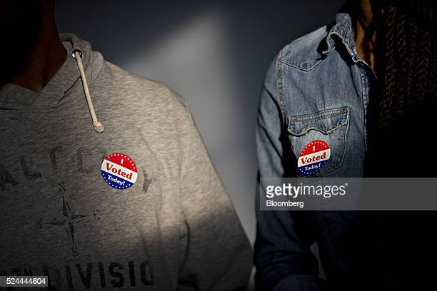 Residents wear I Voted Today stickers after voting at the Francis Myers Recreation Center polling location in Philadelphia Pennsylvania US on Tuesday...