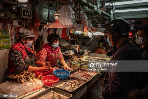 Residents wearing face masks purchase seafood at a wet market on January 28 2020 in Macau China The number of cases of a deadly new coronavirus rose...