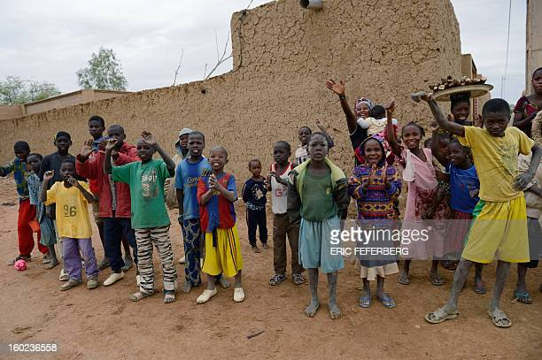 Residents welcome Malian and French soldiers as they enter the historic city of Timbuktu occupied for 10 months by Islamists who imposed a harsh form...