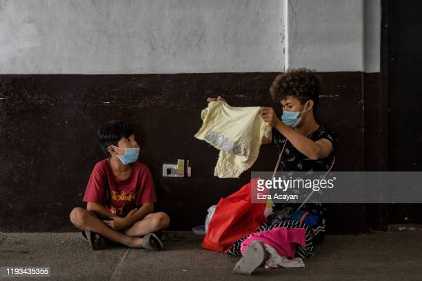 Residents who fled Taal Volcano's eruption occupy an evacuation center on January 13 2020 in Santo Tomas Batangas province Philippines The Philippine...