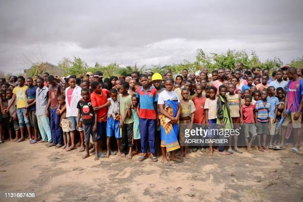Residents who fled the cyclone wait for relief aid in Buzi on March 20 2019 International aid agencies raced on March 20 to rescue survivors and meet...