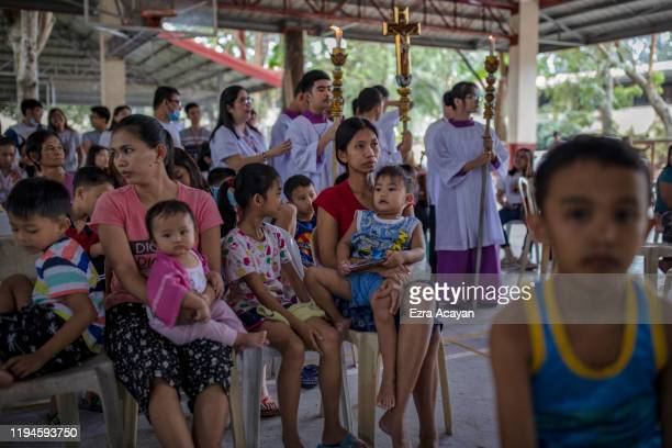 Residents who fled their homes attend Sunday mass at an evacuation center on January 19 2020 in Lipa Batangas province Philippines The Philippine...