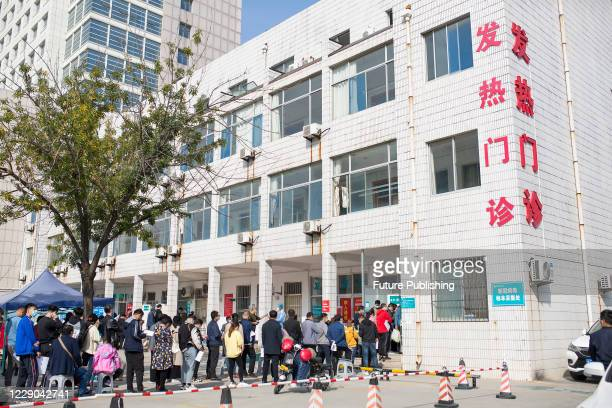 Residents who have recently been to Qingdao queue up for nucleic acid testing, Binzhou City, Shandong Province, China, October 13, 2020.- PHOTOGRAPH...