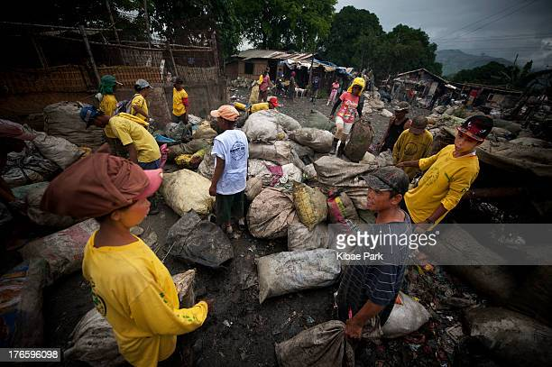 Residents work in a village of San Isidro to earn their money by selling recyclable garbage. San Isidro, situated on the outskirts of Metro Manila in...