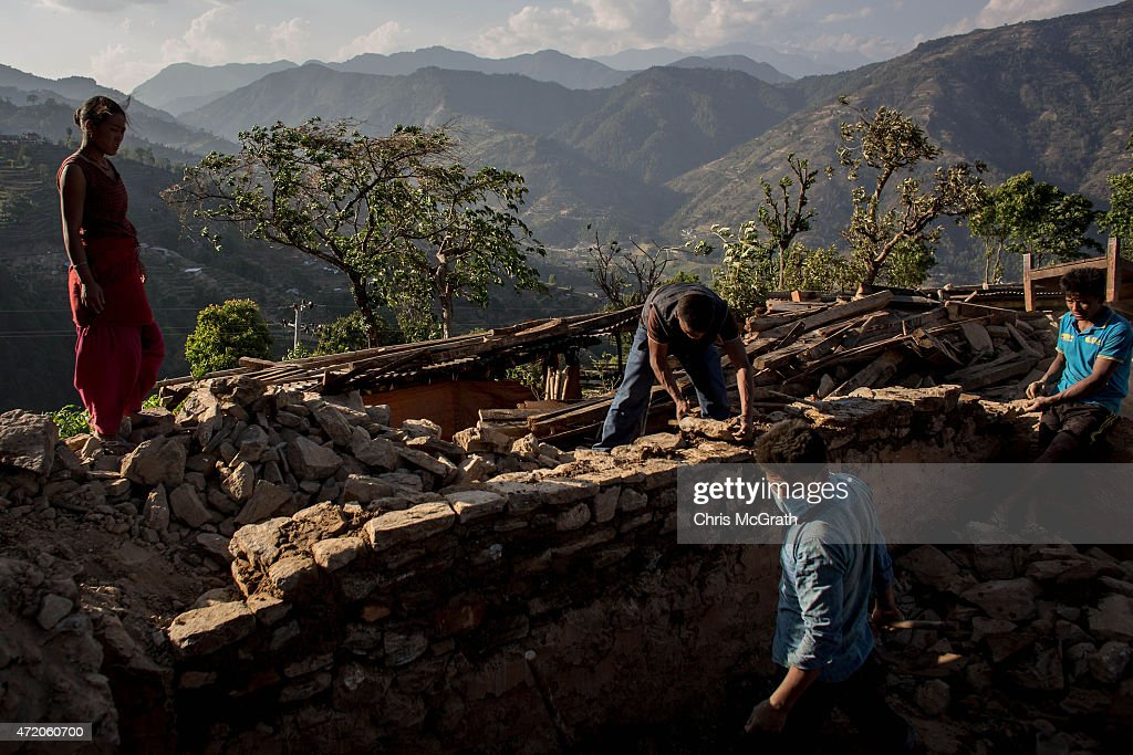 Residents work to rebuild their home in Bhotechaur, Nepal on May 3, 2015 in Kathmandu, Nepal. A major 7.9 earthquake hit Kathmandu mid-day on Saturday, and was followed by multiple aftershocks that triggered avalanches on Mt. Everest that buried mountain climbers in their base camps. Many houses, buildings and temples in the capital were destroyed during the earthquake, leaving over 6000 dead and many more trapped under the debris as emergency rescue workers attempt to clear debris and find survivors. Regular aftershocks have hampered recovery missions as locals, officials and aid workers attempt to recover bodies from the rubble.