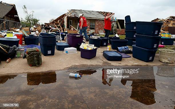Residents work to salvage their belongings from a destroyed neighborhood on May 24 2013 in Moore Oklahoma The tornado of EF5 strength and two miles...