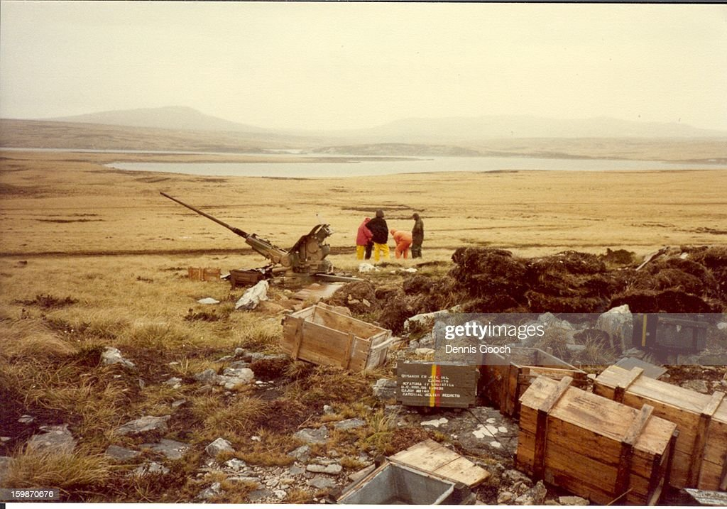 CONTENT] Residue of war. October 1983. On Top of Wireless Ridge looking North towards Hearnden Water.? Colleaques in picture are examining a live shell.