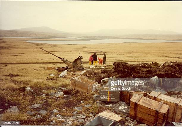 CONTENT] Residue of war October 1983 On Top of Wireless Ridge looking North towards Hearnden Water Colleaques in picture are examining a live shell