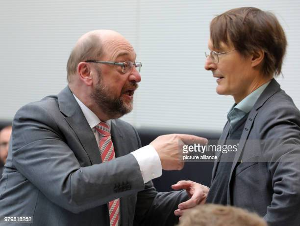 Resigned leader of the Social Democratic Party , Martin Schulz , speaks with Karl Lauterbach before the beginning of the SPDfaction meeting in the...