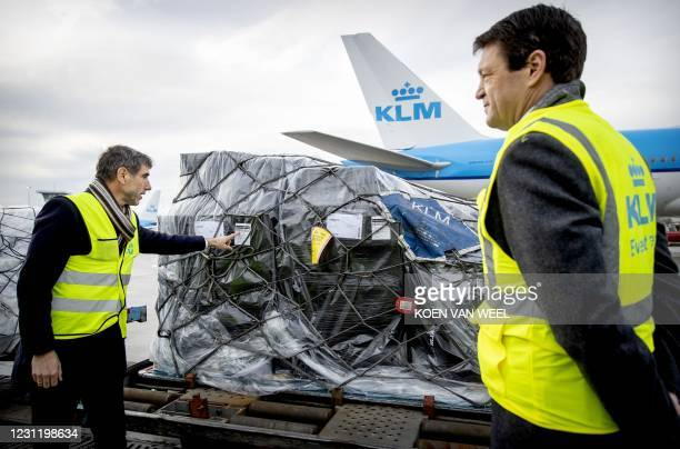 Resigning State Secretary Paul Blokhuis and KLM CEO Pieter Elbers check a KLM aircraft loaded with vaccines against the coronavirus Covid-19 on...