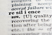 Resilience. Dictionary definition, selective focus. Perseverance, adaptation and dealing with failure concept.