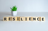 Resilience word concept on cubes on white background