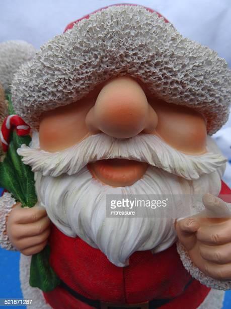 resin cartoon toy santa claus / father christmas, white-beard, garden ornament - cartoon santa claus stock photos and pictures