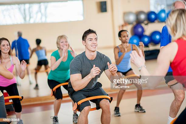 resistance band squats - train band stock photos and pictures