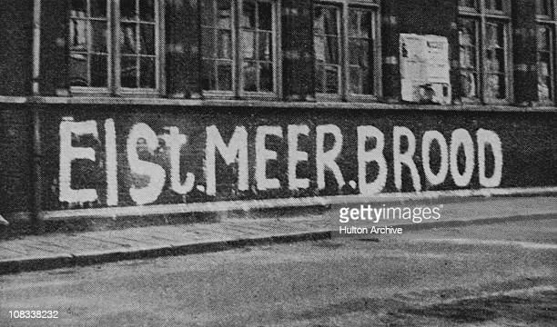 Resistance grafitti in a street in the Netherlands during the Dutch famine of the winter of 194445 The slogan reads 'Eist Meer Brood'