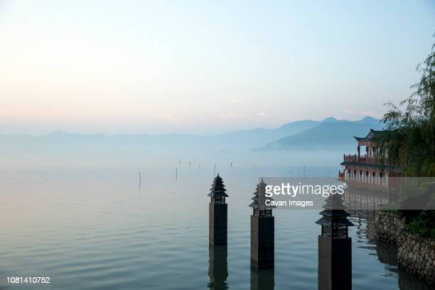 resort docks in lake against sky during sunset - ningbo stock pictures, royalty-free photos & images