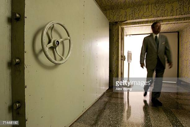 A resort employee passes by the Hotel Blast Door which weighs 18 tons and serves as an entrance to a former government relocation facility also know...