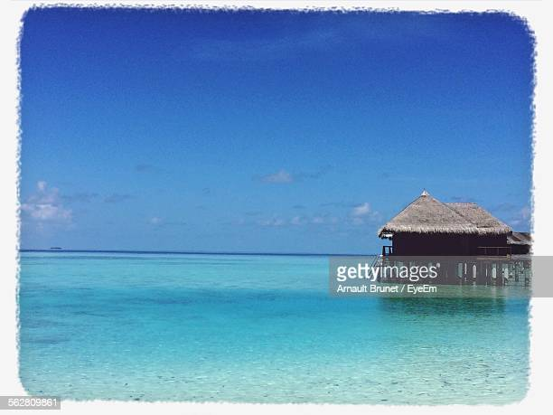resort hut on pier in sea - arnault stock pictures, royalty-free photos & images