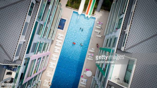resort pool aerial view - standing water stock pictures, royalty-free photos & images