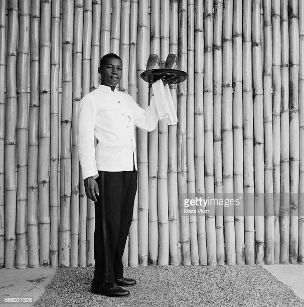 Resort Waiter Holding Tray With Candles