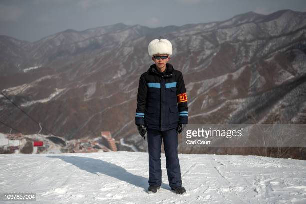 A resort worker poses for a photograph at Masikryong Ski Resort on February 05 2019 near Wonsan North Korea US President Donald Trump and North...