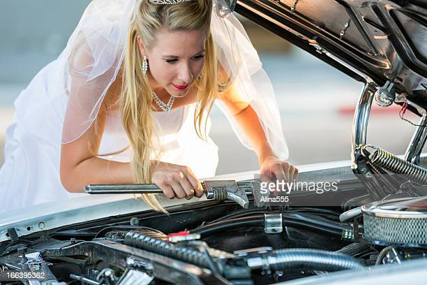 Resourceful bride fixing a car