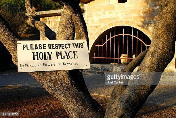 respect for holy places at jerusalem's garden of gethsemane - garden of gethsemane stock pictures, royalty-free photos & images
