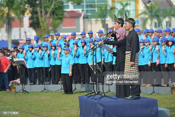 CONTENT] respect pride independence headgear tradition affirmation Malaysia my country blue red green men women slogans fluttered flags free...
