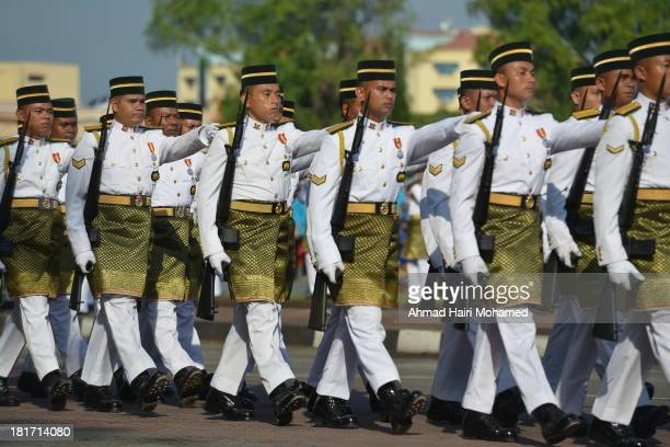 CONTENT] respect pride independence headgear tradition affirmation Malaysia my country blue red green men slogans fluttered flags free community...
