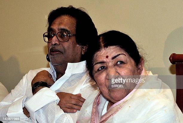 Respected legendary Bollywood playback singer Lata Mangeshkar along with her brother composer and music director pandit Hridayanath Mangeshkar pose...